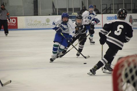 Jake Schaffner handles the puck in traffic for the Bluebirds. His goal in OT won the game.