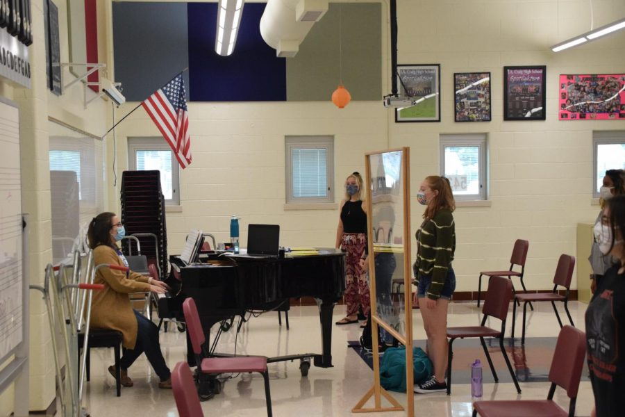 Choir students in Ms. Fischer's class sing from a distance.