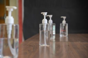 Bottles of hand sanitizer stand on tables in hallways throughout Craig.