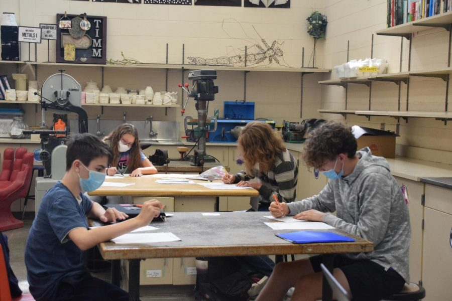 Masked and distanced, students work on their art projects.