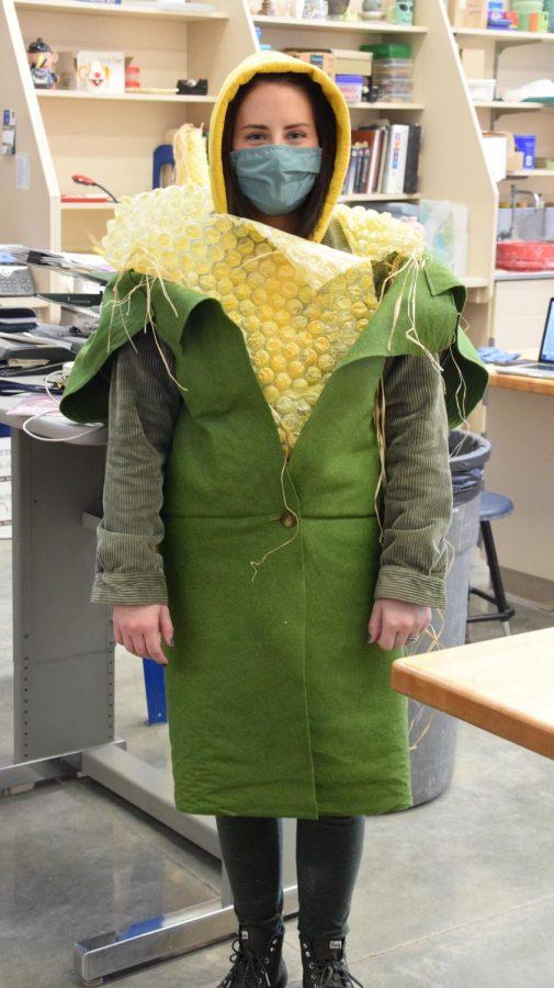 Mrs. Negus celebrates Fall Festival as a cob of corn.