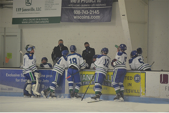 The Bluebirds huddle around the Bench during a Timeout called in the 3rd Period