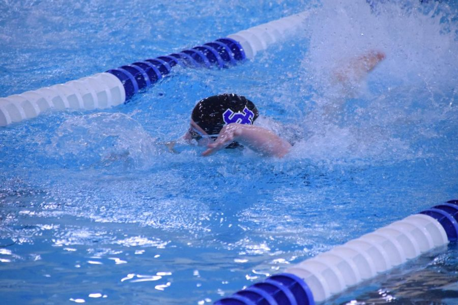 Senior Claire Rusert powers her way through the water during the 50 freestyle.