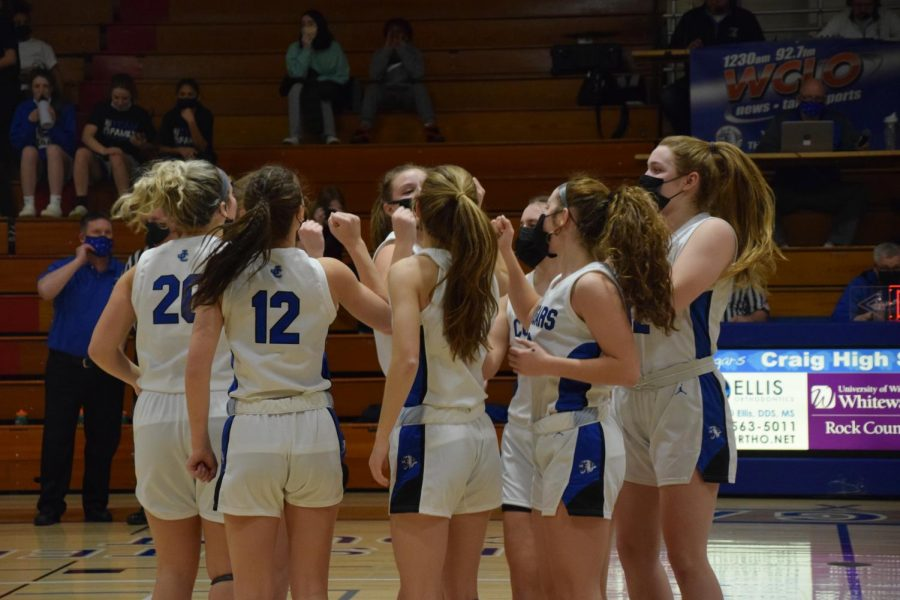 The+Girls+Varsity+Basketball+Team+hype+each+other+up+before+the+start+of+the+game.