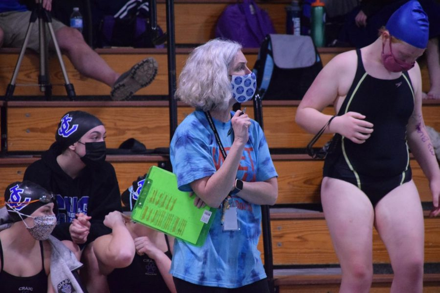 First-year coach Jen Punzel watches the racing and keeps track of times and lineups on her clipboard.