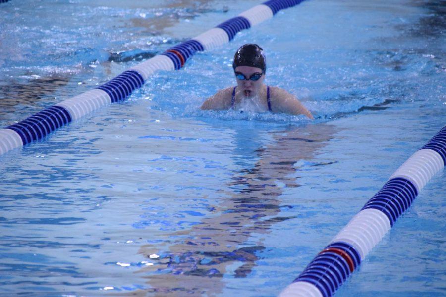 Sophomore Dakota Reece swims the 100 breaststroke. She won in a time of 1:12.76.