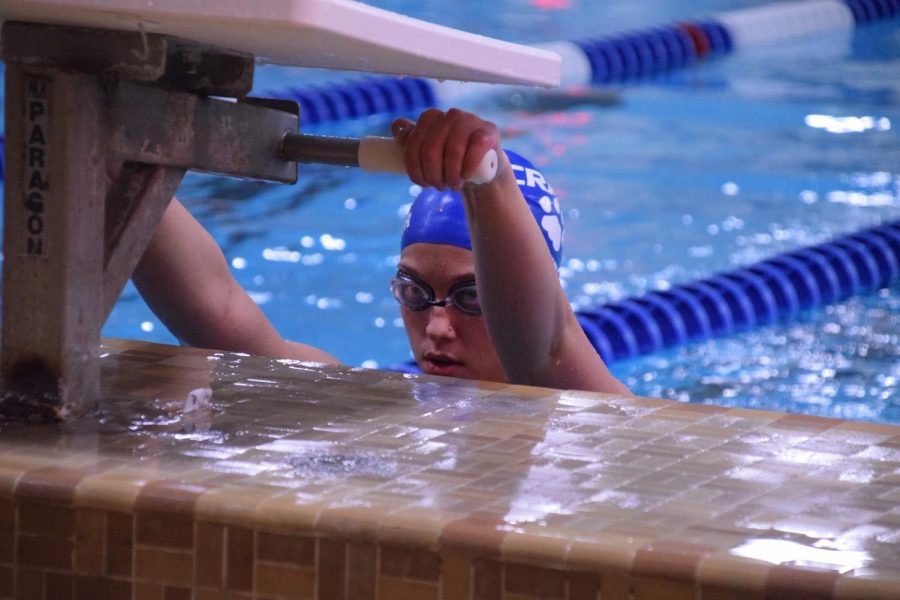 Senior Sam Guenther readies herself for the start of the 100 backstroke.