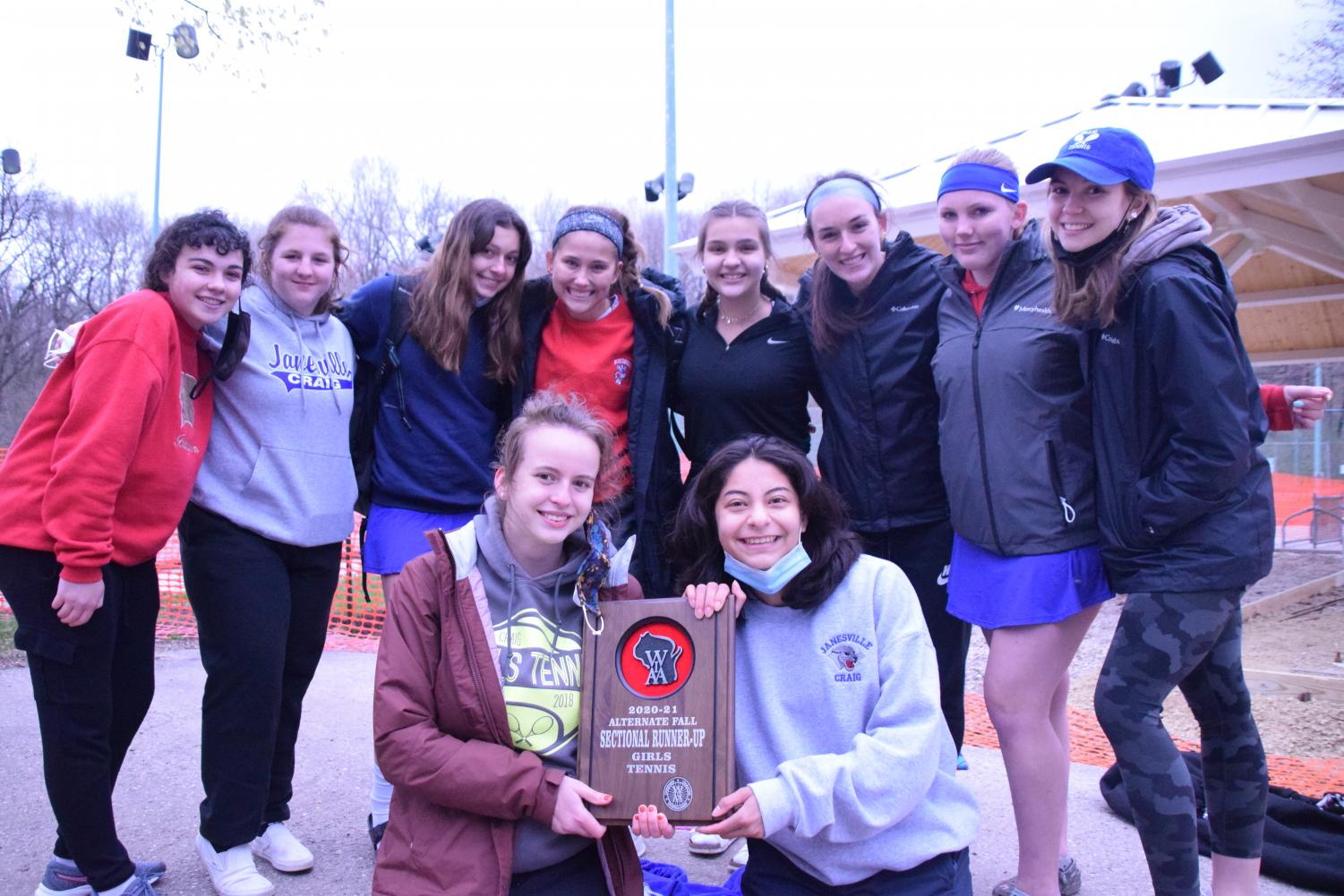 Craigs sectional team poses with their runner-up trophy on Wednesday, April 14, at Palmer Park. From left to right: In the front row (holding the plaque) are Lucia Hyzer and Myrka Ceballos. In the back row are Bridget Reilly, Hattie Plenty, Karyssa Norland, Becca Frank, Ellah Turenne, Allison Grund, Addison Kooyman, and Madison Burrow.